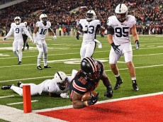 COLUMBUS, OH - OCTOBER 17:  Ezekiel Elliott #15 of the Ohio State Buckeyes scores on a 10-yard touchdown run in the second quarter as Gary Wooten Jr. #8, Trevor Williams #10, Manny Bowen #43, Carl Nassib #95, and Marcus Allen #2, all of the Penn State Nittany Lions, watch at Ohio Stadium on October 17, 2015 in Columbus, Ohio.  (Photo by Jamie Sabau/Getty Images)