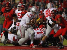 PISCATAWAY, NJ - OCTOBER 24: Quarterback J.T. Barrett #16 of the Ohio State Buckeyes runs for a one yard touchdown against the Rutgers Scarlet Knights during the second period at High Point Solutions Stadium on October 24, 2015 in Piscataway, New Jersey. (Photo by Rich Schultz /Getty Images)
