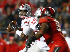 PISCATAWAY, NJ - OCTOBER 24: Quarterback J.T. Barrett #16 of the Ohio State Buckeyes in action against the Rutgers Scarlet Knights during a game at High Point Solutions Stadium on October 24, 2015 in Piscataway, New Jersey. (Photo by Rich Schultz /Getty Images)