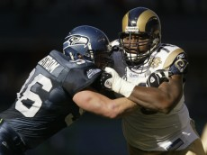 SEATTLE - OCTOBER 10:  Defensive end Grant Wistrom #96 of the Seattle Seahawks blocks tackle Orlando Pace #76 of the St. Louis Rams during the game at Qwest Field on October 10, 2004 in Seattle, Washington. The Rams defeated the Seahawks 33-27 in overtime. (Photo by Otto Greule Jr/Getty Images)
