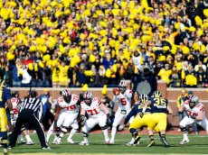 ANN ARBOR, MI - NOVEMBER 30: Quarterback Braxton Miller #5 of the Ohio State Buckeyes takes a snap against Michigan Wolverines during a game at Michigan Stadium on November 30, 2013 in Ann Arbor, Michigan.  (Photo by Gregory Shamus/Getty Images)