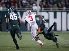 EAST LANSING, MI - NOVEMBER 8: Michael Thomas #3 of the Ohio State Buckeyes runs for a 79-yard touchdown after a reception in the second quarter of the game against the Michigan State Spartans at Spartan Stadium on November 8, 2014 in East Lansing, Michigan. (Photo by Joe Robbins/Getty Images)