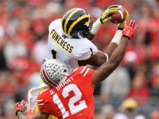 COLUMBUS, OH - NOVEMBER 29:  Devin Funchess #1 of the Michigan Wolverines catches a 45-yard pass in front of Doran Grant #12 of the Ohio State Buckeyes in the first quarter at Ohio Stadium on November 29, 2014 in Columbus, Ohio.  (Photo by Jamie Sabau/Getty Images)