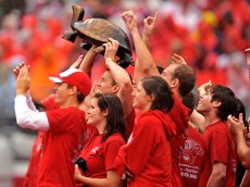 COLUMBUS, OH - SEPTEMBER 26:  Ohio State Buckeyes students hoist the Illibuck trophy during the game against the Illinois Fighting Illinois at Ohio Stadium on September 26, 2009 in Columbus, Ohio. The winner of the game gets to keep the trophy on campus until the next year when the two teams play.  (Photo by Jamie Sabau/Getty Images)