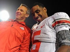 STATE COLLEGE, PA - OCTOBER 27: Quarterback Braxton Miller #5 of the Ohio State Buckeyes smiles with head coach Urban Meyer of the Ohio State Buckeyes after defeating the Penn State Nittany Lions at Beaver Stadium on October 27, 2012 in State College, Pennsylvania. The Ohio State Buckeyes won, 35-23. (Photo by Patrick Smith/Getty Images)