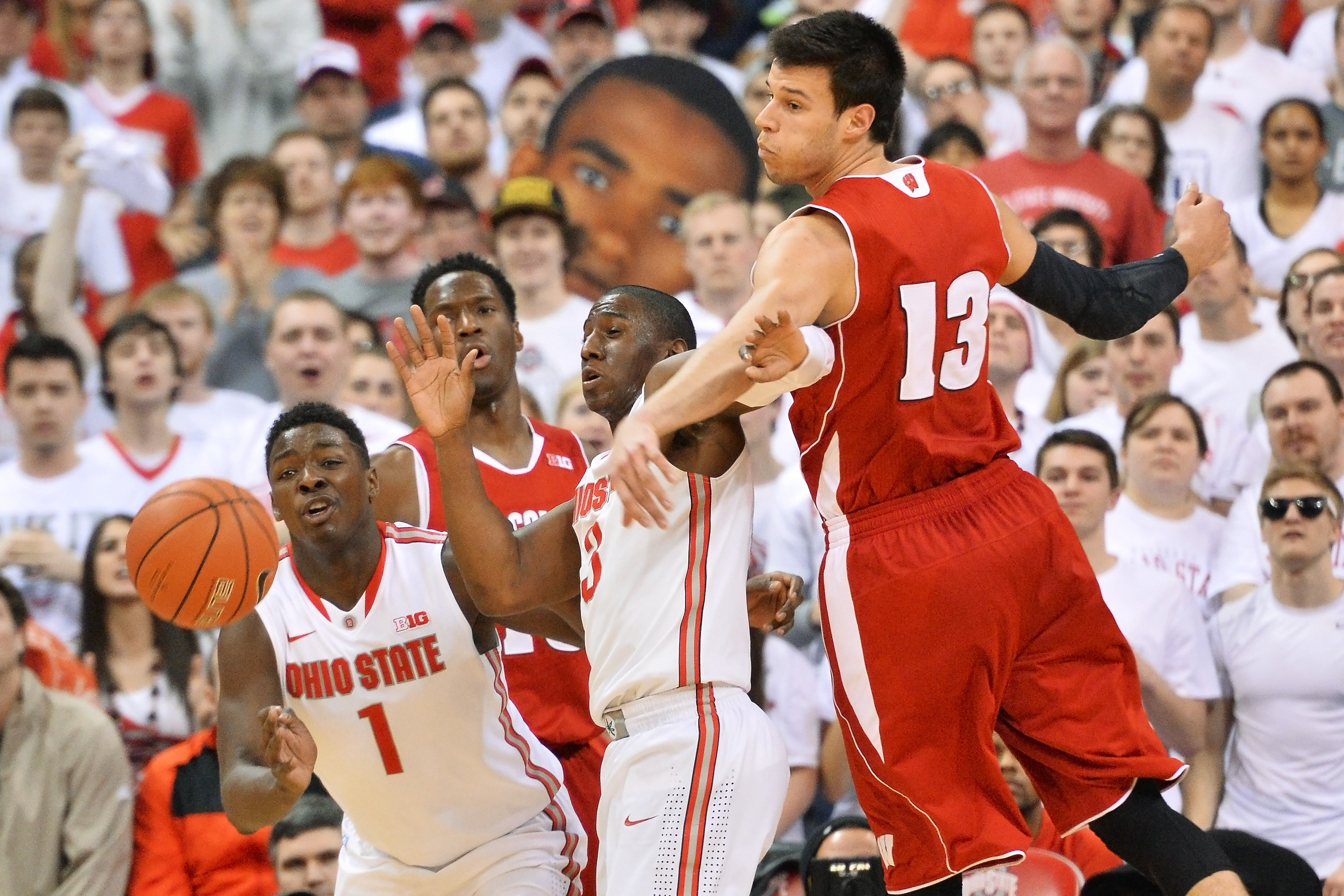 COLUMBUS, OH - MARCH 8:  Jae'Sean Tate #1 of the Ohio State Buckeyes and Shannon Scott #3 of the Ohio State Buckeyes battle for control of a loose ball with Duje Dukan #13 of the Wisconsin Badgers in the second half on March 8, 2015 at Value City Arena in Columbus, Ohio.  Wisconsin defeated Ohio State 72-48.  (Photo by Jamie Sabau/Getty Images)