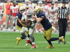 GLENDALE, AZ - JANUARY 01:  James Onwualu #17 and teammate Andrew Trumbetti #98 of the Fighting Irish sack TJ Barrett #16 of the Buckeyes during the BattleFrog Fiesta Bowl at the University of Phoenix Stadium on January 1, 2016 in Glendale, Arizona. Buckeyes won 44-28.  (Photo by Norm Hall/Getty Images)