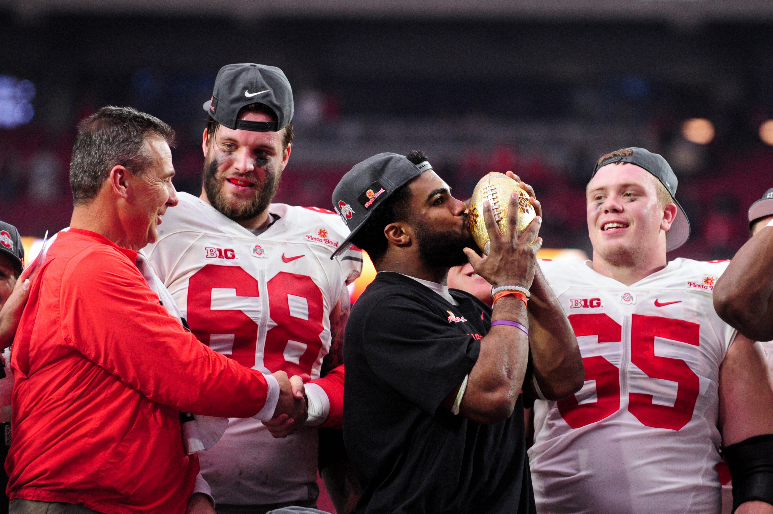 Jan 1, 2016; Glendale, AZ, USA; Ohio State Buckeyes head coach Urban Meyer celebrates with offensive lineman Taylor Decker (68), running back Ezekiel Elliott (15) and offensive lineman Pat Elflein (65) after beating the Notre Dame Fighting Irish 44-28 in the 2016 Fiesta Bowl at University of Phoenix Stadium. Mandatory Credit: Matt Kartozian-USA TODAY Sports