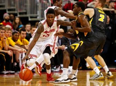 COLUMBUS, OH - DECEMBER 30: Kam Williams #15 of the Ohio State Buckeyes attempts to dribble the ball past Anthony Clemmons #5 of the Iowa Hawkeyes during the first half at Value City Arena on December 30, 2014 in Columbus, Ohio. (Photo by Kirk Irwin/Getty Images)
