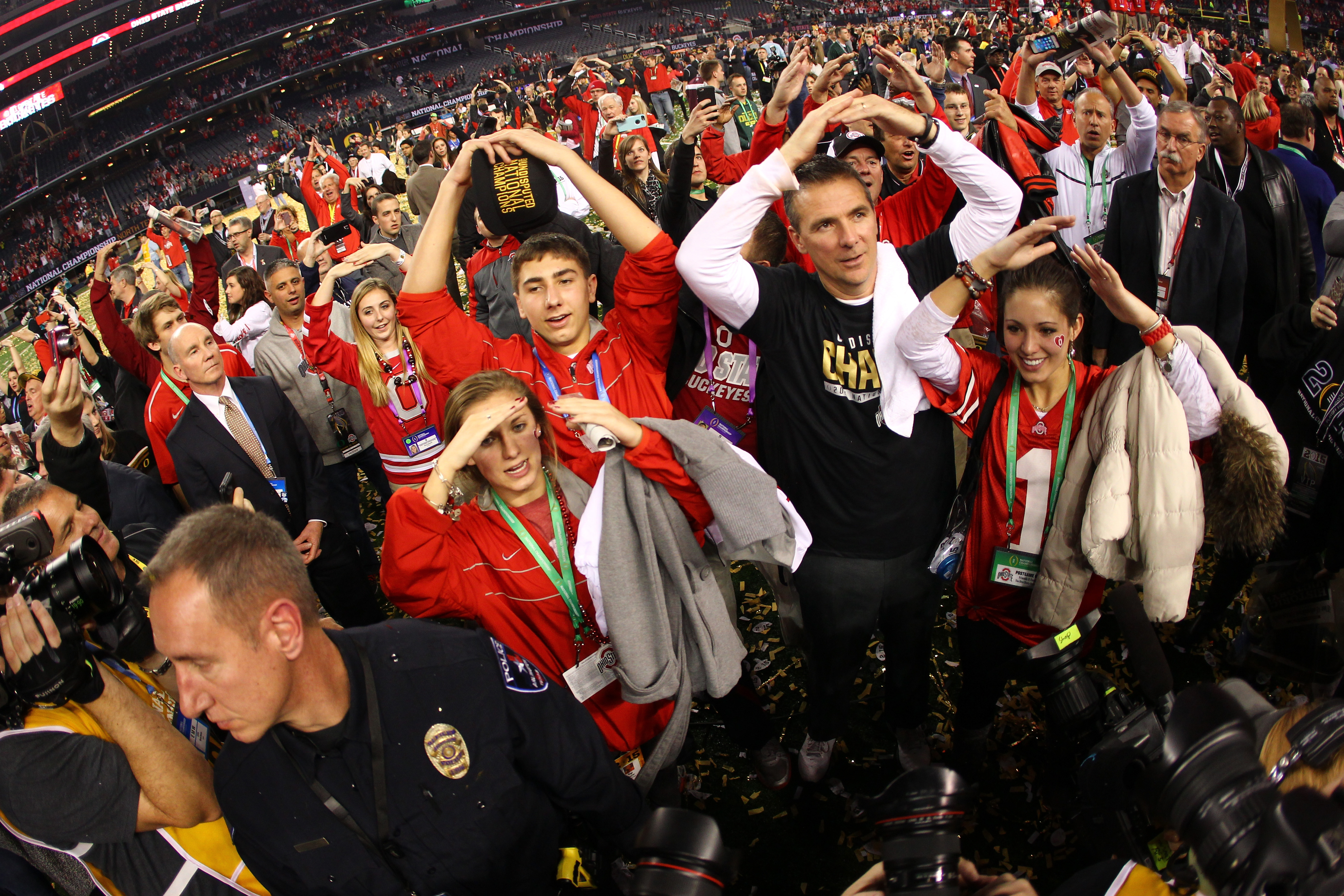 ARLINGTON, TX - JANUARY 12:  Head Coach Urban Meyer of the Ohio State Buckeyes celebrates after defeating the Oregon Ducks 42 to 20 in the College Football Playoff National Championship Game at AT&T Stadium on January 12, 2015 in Arlington, Texas.  (Photo by Jamie Squire/Getty Images)