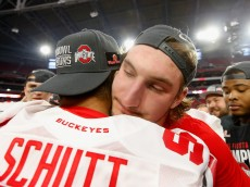 GLENDALE, AZ - JANUARY 01:  Defensive lineman Joey Bosa #97 of the Ohio State Buckeyes hugs Tommy Schutt #90 after defeating the Notre Dame Fighting Irish 44-28 in the BattleFrog Fiesta Bowl at University of Phoenix Stadium on January 1, 2016 in Glendale, Arizona.  (Photo by Christian Petersen/Getty Images)