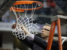 INDIANAPOLIS, IN - MARCH 13:  Assistant coach Jeff Boals of the Ohio State Buckeyes celebrates by cutting down a piece of the net following their 71-60 win against the Penn State Nittany Lions during the championship game of the 2011 Big Ten Men's Basketball Tournament at Conseco Fieldhouse on March 13, 2011 in Indianapolis, Indiana.  (Photo by Andy Lyons/Getty Images)