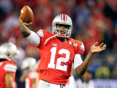 ARLINGTON, TX - JANUARY 12:  Quarterback Cardale Jones #12 of the Ohio State Buckeyes throws a ball during warm-ups before taking on the Oregon Ducks in the College Football Playoff National Championship Game at AT&T Stadium on January 12, 2015 in Arlington, Texas.  (Photo by Jamie Squire/Getty Images)