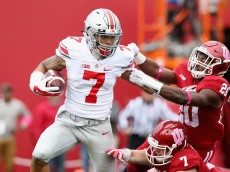 BLOOMINGTON, IN - OCTOBER 03:  Jalin Marshal #7 of the Ohio State Buckeyes runs with the ball while defended by Jameel Cook Jr #20 of the Indiana Hoosiers at Memorial Stadium on October 3, 2015 in Bloomington, Indiana.  (Photo by Andy Lyons/Getty Images)