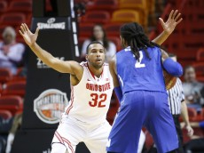 MIAMI, FL - NOVEMBER 27: Trevor Thompson #32 of the Ohio State Buckeyes defends against Shaq Goodwin #2 of the Memphis Tigers on November 27, 2015 at the American Airlines Arena in Miami, Florida. Memphis defeated Ohio State 81-76 in overtime. (Photo by Joel Auerbach/Getty Images)