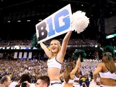 INDIANAPOLIS, IN - DECEMBER 05:  A Michigan State Spartans cheerleader celebrates after the 16-13 win over the Iowa Hawkeyes in the Big Ten Championship at Lucas Oil Stadium on December 5, 2015 in Indianapolis, Indiana.  (Photo by Andy Lyons/Getty Images)