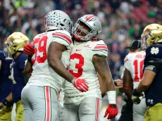 GLENDALE, AZ - JANUARY 01:  Defensive lineman Tyquan Lewis #59 of the Ohio State Buckeyes (left) celebrates a fourth quarter sack with defensive lineman Tracy Sprinkle #93 (right) during the fourth quarter of the BattleFrog Fiesta Bowl against the Notre Dame Fighting Irish at University of Phoenix Stadium on January 1, 2016 in Glendale, Arizona.  (Photo by Jennifer Stewart/Getty Images)