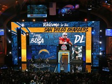 CHICAGO, IL - APRIL 28: Joey Bosa holds his San Diego Chargers jersey during the 2016 NFL Draft at the Auditorium Theater on April 28, 2016 in Chicago, Illinois. (Photo by Jonathan Daniel/Getty Images)