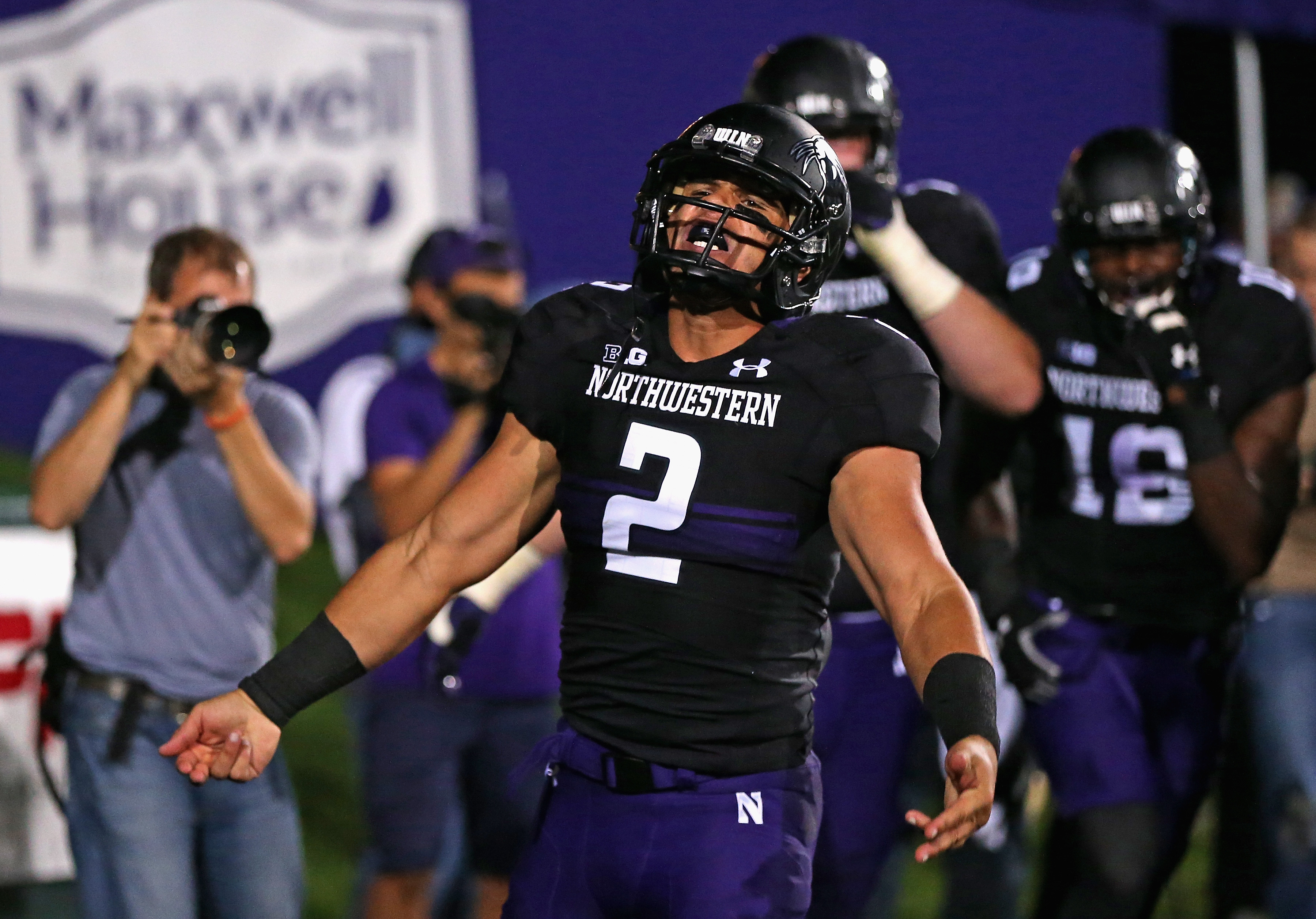 EVANSTON, IL - OCTOBER 05:  Kain Colter #2 of the Northwestern Wildcats celebrates a touchdown catch against the Ohio State Buckeyes at Ryan Field on October 5, 2013 in Evanston, Illinois. Ohio State defeated Northwestern 40-30.  (Photo by Jonathan Daniel/Getty Images)