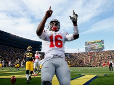 ANN ARBOR, MI - NOVEMBER 28: J.T. Barrett #16 of the Ohio State Buckeyes of the Ohio State Buckeyes celebrates after rushing for a fourth quarter touchdown against the Michigan Wolverines at Michigan Stadium on November 28, 2015 in Ann Arbor, Michigan.  (Photo by Gregory Shamus/Getty Images)
