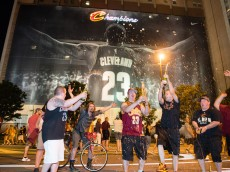 CLEVELAND, OH -  JUNE 19: Fans react in downtown Cleveland after the Cleveland Cavaliers won  the NBA Championship on June 19, 2016 in Cleveland, Ohio. (Photo by Jason Miller/Getty Images)