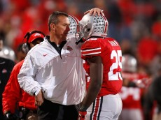 COLUMBUS, OH - NOVEMBER 03:  Head Coach Urban Meyer of the Ohio State Buckeyes congratulates Bri'onte Dunn #25 of the Ohio State Buckeyes after he scored a touchdown against the Illinois Illini on November 3, 2012 at Ohio Stadium in Columbus, Ohio. Ohio State defeated Illinois 52-22. (Photo by Kirk Irwin/Getty Images)