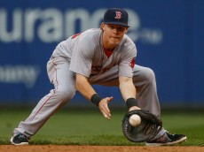 SEATTLE, WA - JUNE 25:  First baseman Brock Holt #26 of the Boston Red Sox fields a grounder off the bat of Brad Miller of the Seattle Mariners in the fifth inning at Safeco Field on June 25, 2014 in Seattle, Washington.  (Photo by Otto Greule Jr/Getty Images)