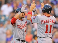 DENVER, CO - JULY 21:  Ian Desmond #20 of the Washington Nationals is congratulated by Ryan Zimmerman #11 after hitting a two-run home run during the fourth inning against the Colorado Rockies at Coors Field on July 21, 2014 in Denver, Colorado.  (Photo by Justin Edmonds/Getty Images)