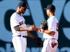 BOSTON, MA - SEPTEMBER 27:  Xander Bogaerts #2 and Mookie Betts #50 of the Boston Red Sox celebrate after defeating the New York Yankees 10-4 in a game at Fenway Park on September 27, 2014 in Boston, Massachusetts.  (Photo by Elsa/Getty Images)