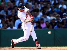 BOSTON, MA - SEPTEMBER 28: Mookie Betts #50 of the Boston Red Sox hits a single in the first inning against the New York Yankees during the last game of the season at Fenway Park on September 28, 2014 in Boston, Massachusetts.  (Photo by Elsa/Getty Images)