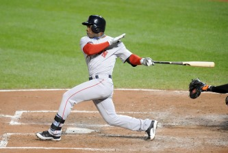 BALTIMORE, MD - SEPTEMBER 19:  Rusney Castillo #38 of the Boston Red Sox gets a base hit in the forth inning a baseball game against the Baltimore Orioles on September 19, 2014 at Oriole Park at Camden Yards in Baltimore, Maryland.  Photo by Mitchell Layton/Getty Images)