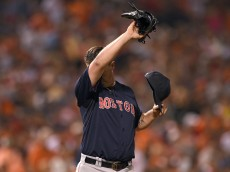 BALTIMORE, MD - SEPTEMBER 20: Pitcher Steven Wright #65 of the Boston Red Sox wipes his face in the seventh inning after giving up a hit to Nelson Cruz #23 of the Baltimore Orioles at Oriole Park at Camden Yards on September 20, 2014 in Baltimore, Maryland. The Baltimore Orioles won, 7-2. (Photo by Patrick Smith/Getty Images)