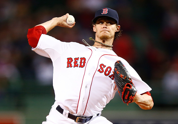 BOSTON, MA - SEPTEMBER 23:  Clay Buchholz #11 of the Boston Red Sox pitches against the Tampa Bay Rays in the first inning during the game at Fenway Park on September 23, 2014 in Boston, Massachusetts.  (Photo by Jared Wickerham/Getty Images)