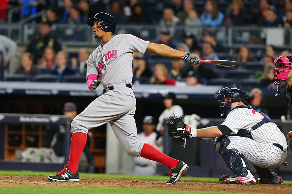 NEW YORK, NY - MAY 08:  Xander Bogaerts #2 of the Boston Red Sox connects on a solo home run in the eighth inning against the New York Yankees at Yankee Stadium on May 8, 2016 in the Bronx borough of New York City.  (Photo by Mike Stobe/Getty Images)