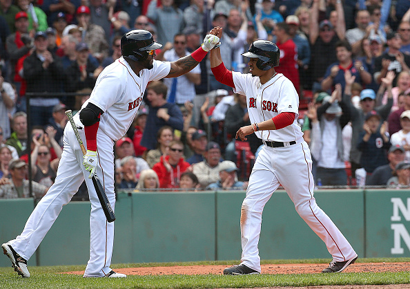 BOSTON, MA - MAY 22:  David Ortiz #34 of the Boston Red Sox celebrates after Mookie Betts #50 scored in the sixth inning against the Cleveland Indians at Fenway Park on May 22, 2016 in Boston, Massachusetts.  (Photo by Jim Rogash/Getty Images)