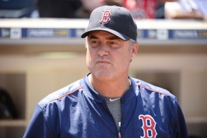 SAN DIEGO, CALIFORNIA - SEPTEMBER 5: John Farrell #53 of the Boston Red Sox looks out from the dugout before a baseball game against the San Diego Padres at PETCO Park on September 5, 2016 in San Diego, California. (Photo by Denis Poroy/Getty Images)