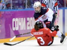 SOCHI, RUSSIA - FEBRUARY 20: Monique Lamoureux #7 of the United States body checks Jocelyne Larocque #3 of Canada during the Ice Hockey Women's Gold Medal Game on day 13 of the Sochi 2014 Winter Olympics at Bolshoy Ice Dome on February 20, 2014 in Sochi, Russia. (Photo by Harry How/Getty Images)