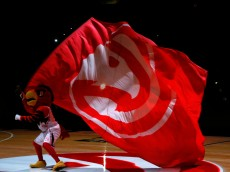 ATLANTA, GA - JANUARY 07:  Harry the Hawk waves a flag during pregame introductions prior to the game between the Atlanta Hawks and the Memphis Grizzlies at Philips Arena on January 7, 2015 in Atlanta, Georgia.  NOTE TO USER: User expressly acknowledges and agrees that, by downloading and or using this photograph, User is consenting to the terms and conditions of the Getty Images License Agreement.  (Photo by Kevin C. Cox/Getty Images)