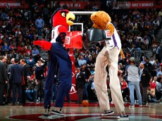 ATLANTA, GA - MARCH 09:  Harry the Hawk, mascot of the Atlanta Hawks, boxes on stilts with another mascot during the game between the Atlanta Hawks and the Sacramento Kings at Philips Arena on March 9, 2015 in Atlanta, Georgia.  NOTE TO USER: User expressly acknowledges and agrees that, by downloading and/or using this photograph, user is consenting to the terms and conditions of the Getty Images License Agreement.  (Photo by Kevin C. Cox/Getty Images)