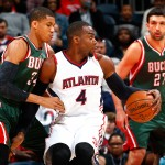 ATLANTA, GA - MARCH 30:  Paul Millsap #4 of the Atlanta Hawks drives against Giannis Antetokounmpo #34 of the Milwaukee Bucks at Philips Arena on March 30, 2015 in Atlanta, Georgia.  NOTE TO USER: User expressly acknowledges and agrees that, by downloading and/or using this photograph, user is consenting to the terms and conditions of the Getty Images License Agreement.  (Photo by Kevin C. Cox/Getty Images)
