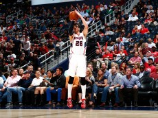 ATLANTA, GA - MARCH 30:  Kyle Korver #26 of the Atlanta Hawks shoots a three-point basket against the Milwaukee Bucks at Philips Arena on March 30, 2015 in Atlanta, Georgia.  NOTE TO USER: User expressly acknowledges and agrees that, by downloading and/or using this photograph, user is consenting to the terms and conditions of the Getty Images License Agreement.  (Photo by Kevin C. Cox/Getty Images)