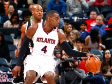 ATLANTA, GA - APRIL 04:  Paul Millsap #4 of the Atlanta Hawks spins against Jarrett Jack #0 of the Brooklyn Nets at Philips Arena on April 4, 2015 in Atlanta, Georgia.  NOTE TO USER: User expressly acknowledges and agrees that, by downloading and/or using this photograph, user is consenting to the terms and conditions of the Getty Images License Agreement.  (Photo by Kevin C. Cox/Getty Images)