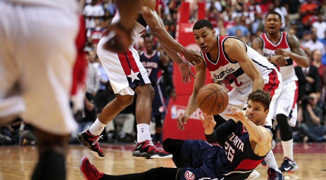 WASHINGTON, DC - MAY 11: Kyle Korver #26 of the Atlanta Hawks passes in front of Otto Porter Jr. #22 of the Washington Wizards during the second half in Game Four of the Eastern Conference Semifinals of the 2015 NBA Playoffs at Verizon Center on May 11, 2015 in Washington, DC. The Atlanta Hawks won, 106-101. NOTE TO USER: User expressly acknowledges and agrees that, by downloading and or using this photograph, User is consenting to the terms and conditions of the Getty Images License Agreement. (Photo by Patrick Smith/Getty Images)