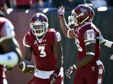 Oct 10, 2015; Philadelphia, PA, USA; Temple Owls defensive back Sean Chandler (3) celebrates his touchdown with defensive back Delvon Randall (26) against the Tulane Green Wave at Lincoln Financial Field. The Temple Owls won 49-10. Mandatory Credit: Derik Hamilton-USA TODAY Sports