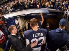 Sam Ficken (97) is cheered by fans as he leaves the field following the Pinstripe Bowl.  The Nittany Lions finished the 2014 campaign with a thrilling 31-30 win over Boston College in the Pinstripe Bowl inside Yankee Stadium on Saturday night. Photo by Mark Selders