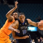 LAS VEGAS, NV - NOVEMBER 26:  James Woodard #10 of the Tulsa Golden Hurricane drives against Jeff Newberry #22 of the Oklahoma State Cowboys during the championship game of the 2014 MGM Grand Main Event basketball tournament at the MGM Grand Garden Arena on November 26, 2014 in Las Vegas, Nevada. Oklahoma State won 73-58.  (Photo by Ethan Miller/Getty Images)
