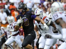 BLACKSBURG, VA - SEPTEMBER 13:  Tight end Bryce Williams #80 of the East Carolina Pirates rushes up field after a reception in the first half against Virginia Tech at Lane Stadium on September 13, 2014 in Blacksburg, Virginia. East Carolina leads Virginia Tech 21-7 at halftime. (Photo by Michael Shroyer/Getty Images)