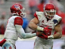 FORT WORTH, TX - JANUARY 02: Greg Ward Jr. #1 of the Houston Cougars hands off to Kenneth Farrow #35 during the Lockheed Martin Armed Forces Bowl game against the Pittsburgh Panthers at Amon G. Carter Stadium on January 2, 2015 in Fort Worth, Texas.  (Photo by Sarah Glenn/Getty Images)
