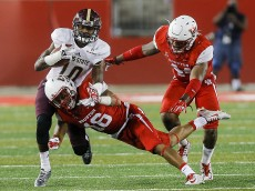 HOUSTON, TX - SEPTEMBER 26:  Demun Mercer #10 of the Texas State Bobcats is tackled by Adrian McDonald #16 of the Houston Cougars as Elandon Roberts #44 pursues on September 26, 2015 in Houston, Texas.  (Photo by Bob Levey/Getty Images)