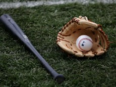 CHICAGO - APRIL 09:  A bat, glove and ball rest on the field before the Chicago Cubs' home opening game against the Houston Astros on April 9, 2007 at Wrigley Field in Chicago, Illinois. (Photo by Jonathan Daniel/Getty Images)